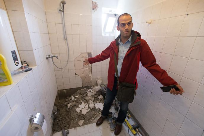 Kuscha Alipoor shows the bathroom he is renovating in his family's apartment at the United Methodist Church of the Redeemer in Bremen, Germany. Alipoor, who took sanctuary at the church, while fighting deportation, is now a member of the church and works as the building superintendent. Photo by Mike DuBose, UMNS.