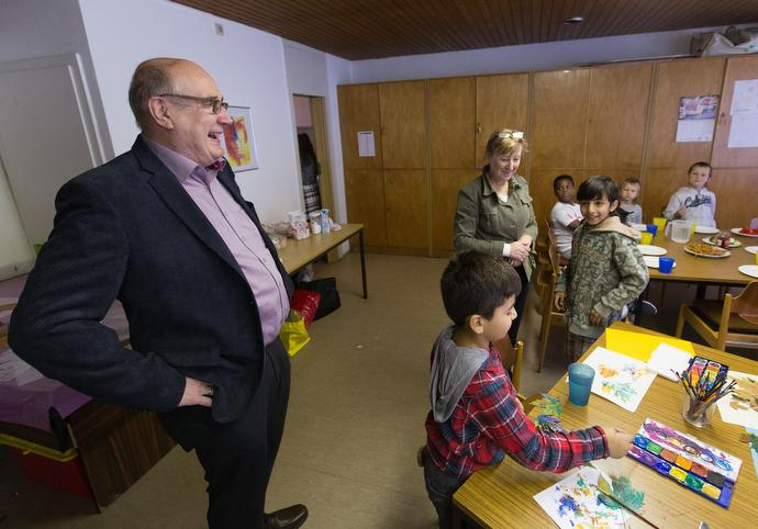 The Rev. Karsten Mohr (left) visits with immigrant children in an educational enrichment program at the United Methodist Peace Church in Hamburg, Germany. Photo by Mike DuBose.