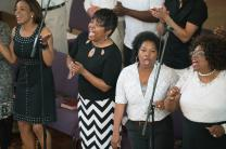 The choir at First Grace United Methodist Church led a rousing worship for members of the United Methodist Association of Communicators on March 23. The church, formed when two churches merged after Hurricane Katrina, has become a sanctuary church. Photo by Art McClanahan, UMNS