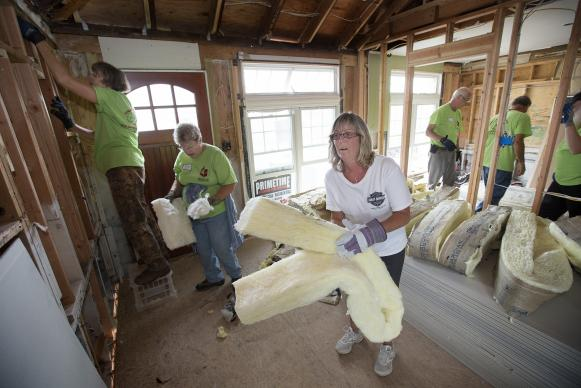Lisa Mentges (center) works with a United Methodist volunteer team in October 2013 to repair her home in Long Beach, N.Y. after it was flooded by Hurricane Sandy. The volunteers are from the California-Pacific Conference. United Methodists have continued to help with recovery in the five years following the storm. File photo by Mike DuBose, UMNS.