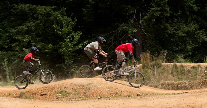 Scouts try BMX racing at the 2017 National Scout Jamboree at the Summit Bechtel Reserve in Glen Jean, W.Va. Photo by Mike DuBose, UMNS.
