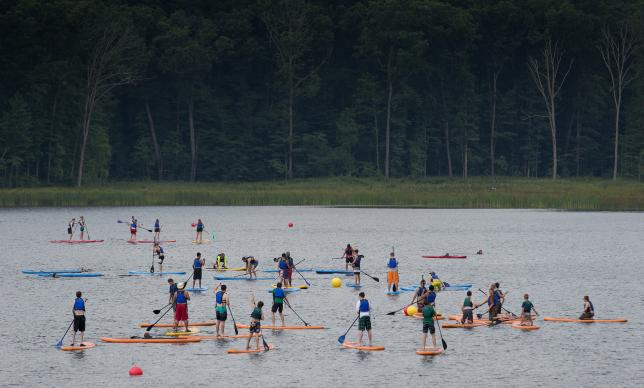 Scouts try paddle boarding at the 2017 National Scout Jamboree held July 19-28 at the Summit Bechtel Reserve in Glen Jean, W.Va. The United Methodist Church is the second-largest faith group represented at the event, with 3,500 professed United Methodists at the Boy Scouts of America's quadrennial celebration. Photo by Mike DuBose, UMNS.