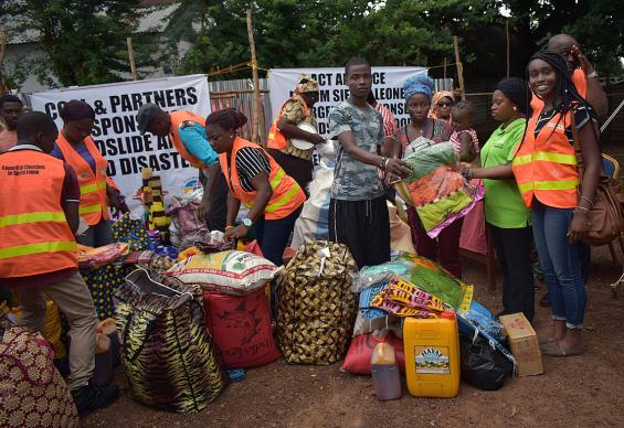 In September, the Council of Churches in Sierra Leone, led by United Methodist Bishop John Yambasu, distributed about $82,000 worth of food, bowls, blankets and other relief items to mudslide survivors at a new relocation camp in Juba, western Freetown. Photo by Phileas Jusu, UMNS.