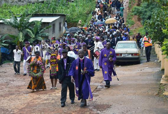 Clergy from the Council of Churches of Sierra Leone lead a procession of worshippers to an area at the bottom of Mount Sugar Loaf where hundreds of bodies that were not recovered are still buried under the rubble of a devastating landslide. A service of remembrance and thanksgiving for the victims and survivors was held at the bottom of Mount Sugar Loaf, Aug. 27. Photo by Phileas Jusu, UMNS.