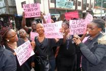 United Methodist Women hold up placards with inscriptions calling for an end to violence against females in Freetown on July 27. The women from the Sierra Leone Annual Conference took to the streets to protest against the growing violence against women and girls in the country.