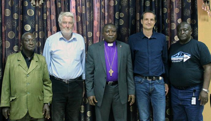 From left, the Rev. Robert Sieh, Stein Skjorshammer, Bishop Samuel J. Quire, Pietr Kwasowski and the Rev. George D. Wilson Jr. gathered after a meeting. Photo by Julu Swen, UMNS.