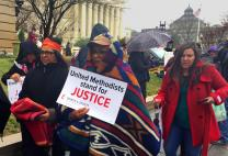 Doris Cooper, third from left, and Joyce Robins-Brown, second from left, joined thousands of other protesters, including United Methodists, who marched to oppose President Donald Trump's executive order allowing construction on the Dakotas Access pipeline to resume. The Standing Rock Sioux Tribe, based in North Dakota, organized the Native Nations March.  Photo by Erik Alsgaard, UMNS.