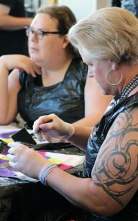 Sasha Strock engages in an art station led by Grace Cox-Johnson during Rooted, an ecumenical trans and gender-expanded retreat held in Chicago Aug. 11-13.