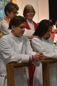 The ordination process for M Barclay, at left, continues with the provisional deacon facing another evaluation of clergy credentials again in 2019.  Photo by Anne Marie Gerhardt, Northern Illinois Conference.