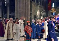 The Rev. Dr. Liberato C. Bautista, head of the U.N. and International Affairs office of the United Methodist Board of Church and Society, and Bishop Christian Alsted, episcopal leader for Northern Europe (third and fourth from left), walk in procession inside the National Cathedral in Trondheim. A service held in the Cathedral was part of the 100-year celebration of the first Sami Congress. Photo by Karl Anders Ellingsen.