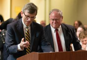 Richard Marsh (left) and the Rev. Keith Boyette (right), representatives for opposing sides, prepare to present their arguments before the United Methodist Judicial Council. Photo by Mike DuBose, UMNS