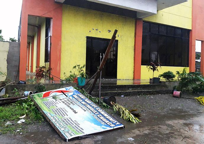 The sign for the Light and Life United Methodist Church in Tacloban City, Philippines, lies on the ground in front of the building after Typhoon Urduja brought strong winds and rain to the area on Dec. 16. The church served as an evacuation place for church members and some six families from the community whose houses were flooded. Photo courtesy of Iris Picardal-Terana and Ronnel Tuscano de Juan, Light and Life United Methodist Church.