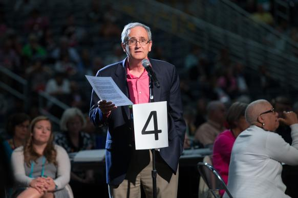 Delegate George Howard moves to approve a request from the United Methodist Council of Bishops during the 2016 General Conference in Portland, Ore. General Conference agreed to let the bishops name a commission charged with advising how the denomination might stay together despite divisions over homosexuality. The Commission on a Way Forward's closed-door meetings approach has found support and criticism. File photo by Mike DuBose, UMNS.