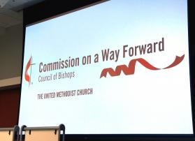 The logo for the Commission on a Way Forward is projected onto a screen during the group's first face-to-face meeting in January 2017. Photo by Diane Degnan, United Methodist Communications.