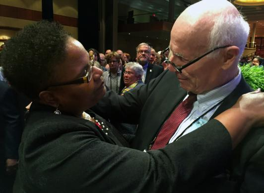 The Rev. J. Phil Wogaman (right) and Bishop LaTrelle Miller Easterling greet each other during the 233rd session of the Baltimore-Washington Conference in Washington, D.C. Wogaman handed in his clergy credentials during the clergy session over the case of T.C. Morrow, a lesbian who was not approved for ordination as a deacon in 2016 or 2017 and for others he feels have been excluded. Photo by Dawn M. Hand, Foundry United Methodist Church.
