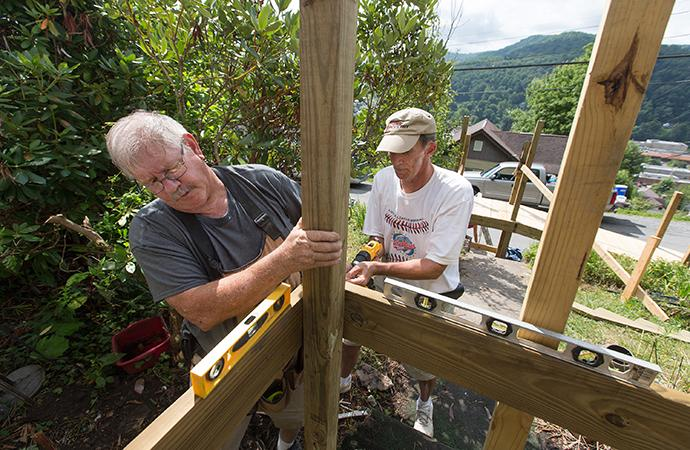 Wayne Davis (left) and the Rev. Russell Lee work to restore access to a home in Richwood, W. Va., that was damaged by runoff from a June 2016 flood. Davis is from Byrd Chapel United Methodist Church in Kents Store, Va., and Lee is pastor of First Presbyterian Church in South Boston, Va. Photo by Mike DuBose, UMNS.