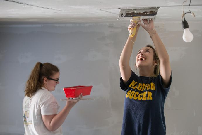 Volunteers Beth Carter (right) and Josie Johnson of South Roanoke (Va.) United Methodist Church help repair a home in the Swinging Bridge community near Clay, W. Va. Photo by Mike DuBose, UMNS.