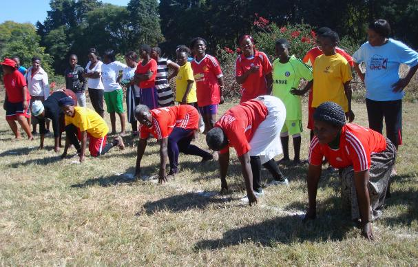 Women in the over 60s division line up for a race at a sports gala at Selborne Routledge Primary School in Harare, sponsored by the Zimbabwe Episcopal Area women's organization, RukwadzanoRweWadzimai, to promote exercise for health. Tendai Gurupira, vice president of RukwadzanoRweWadzimai, said exercising is a cheaper and safer alternative to pharmaceutical medicine. Photo by Kudzai Chingwe, UMNS.
