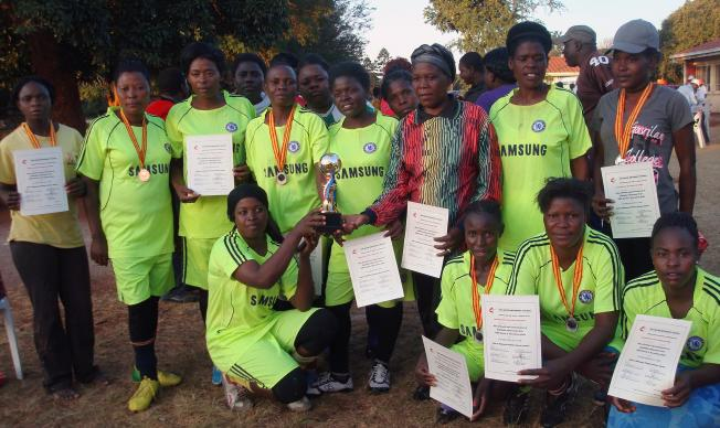 The wining soccer team from the Domboramwari Circuit pose with their trophy during a sports gala held at Selborne Routledge Primary School in Harare. The two United Methodist conferences in Zimbabwe competed in a sports event aimed at promoting exercise for health. Photo by Kudzai Chingwe, UMNS.