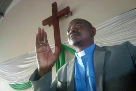 The Rev. Tauri Emmanuel Maforo gives the sermon during a prayer service at St. Dorcas United Methodist Church in Harare, Zimbabwe, following a military takeover of the capital. Photo by Promise Karuwenga.