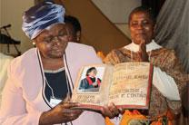Bishop Joaquina F. Nhanala of Mozambique is presented with a carving to commemorate her decade as the first and only female United Methodist bishop in Africa during a celebration at Africa University in Mutare, Zimbabwe. Photo by Eveline Chikwanah, UMNS.