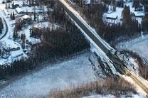 The Nov. 30 earthquake that hit south central Alaska damaged roads and buildings, and in some areas knocked out power and water for a time. No deaths were reported, only minor injuries, and strict building codes apparently prevented building collapses. Photo courtesy of Air National Guard/U.S. Army.