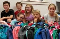 Volunteers from Wesley Church in Bethlehem, Penn. handed out new backpacks, school supplies, clothing, hot dogs, and offered free haircuts to elementary school children. Photo courtesy of Wesley Church.