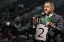 The Rev. Mark Holland of the Great Plains Conference makes a motion during the 2016 United Methodist General Conference in Portland, Ore. He was part of group of delegates who met July 13-15 in Nashville, Tenn., to build relationships and discuss the One Church Model. File photo by Maile Bradfield, UMNS.