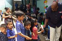Bishop Holston shares health kits with elementary students in Chusajcaba, Guatemala. Photo by the Rev. Ken Nelson.