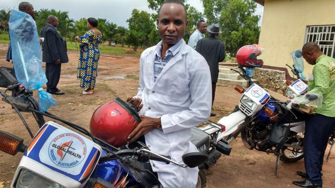 Dr. Kaly Kayamba Tombe sits on a motorbike delivered by the North Katanga Conference. The United Methodist Board of Global Ministries' Global Health unit provided funding for the bikes, as well as computers, mobile phones and modems, to improve patient care and data collection in Kamina, Democratic Republic of Congo. Photo by the Rev. Betty Kazadi Musau, UMNS