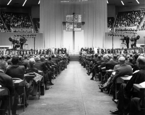 A view of the platform from the floor of the 1968 uniting conference in Dallas, where a merger of the Methodist Church and Evangelical United Brethren Church resulted in The United Methodist Church. The Commission on Archives and History offers a number of archives and resources on the history of Methodism. 1968 file photo courtesy of the United Methodist Commission on Archives and History.