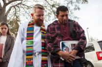 The Rev. Andy Oliver of Allendale United Methodist Church in St. Petersburg prays with Luis Blanco in front of the Tampa immigration office on January 30, 2018. Blanco was deported to Mexico on Feb. 8. Photo courtesy of the Rev. Andy Oliver.