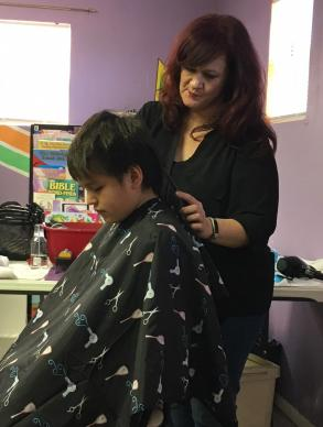 Nikki Humbles, a licensed cosmetologist from Brock, Texas, drove four hours on Jan. 27, 2018, to provide free haircuts to Native youth at Clinton Church and Community Center in Clinton, Okla. Humbles became involved with the Clinton ministry after attending a mission trip with Brock United Methodist Church in July 2016. Photo courtesy of Clinton Church and Community Center.