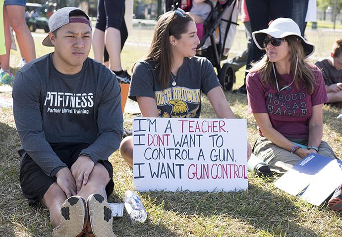 Thousands of supporters came to Pine Lake Park to support students rallying for gun law change. The park is one mile from Marjory Stoneman Douglas High School where 17 people were killed on Feb. 14. Photo by Kathy L. Gilbert, UMNS.