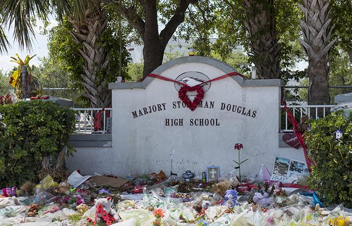 Tributes line the front of Marjory Stoneman Douglas High School for the 17 people slain on Feb. 14. Photo by Kathy L. Gilbert, UMNS.