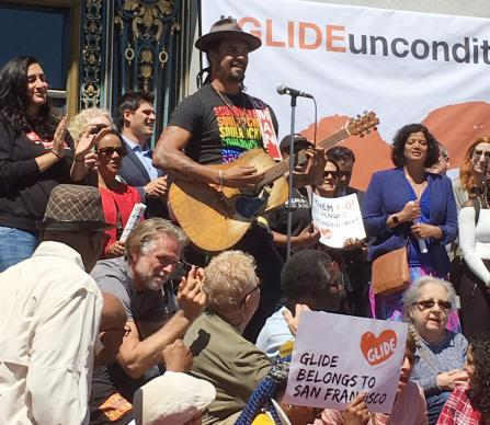 Singer Michael Franti joins the rally for Glide Memorial United Methodist Church in front of San Francisco's City Hall on June 21.