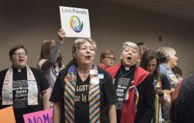 Supporters for the Rev. David Meredith sing at the end of the hearing concerning which charges the Ohio elder faces for his 2016 marriage to another man. Photo by Kathy L. Gilbert