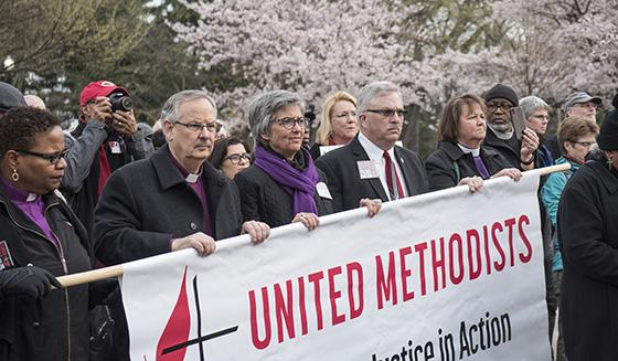 United Methodist Bishops Bruce R. Ough and LaTrelle Easterling spoke at a prayer witness on the eve of a national rally to end racism. Photo by Kathy L. Gilbert, UMNS