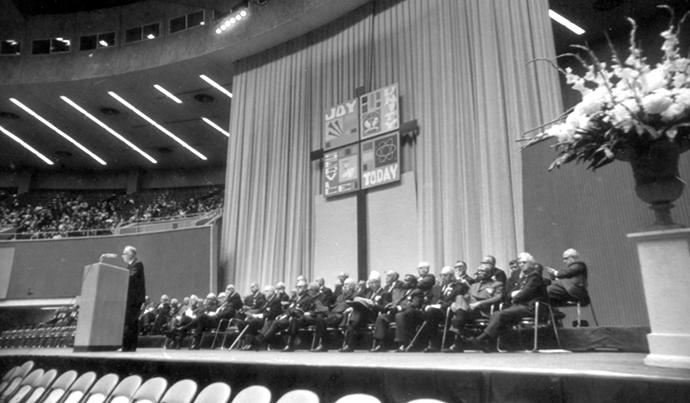 The Rev. Albert C. Outler preaches during the April 23, 1968, uniting service of the Uniting Conference, in Dallas. Outler, a renowned professor at Perkins School of Theology, spoke just before the official creation of The United Methodist Church from union of the Methodist Church and Evangelical United Brethren Church. Photo courtesy of United Methodist Commission on Archives and History.