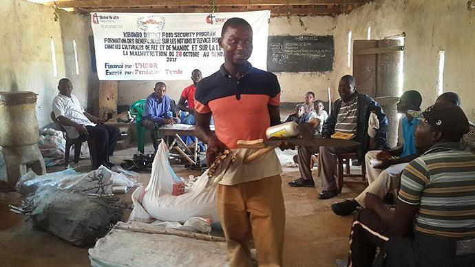 A man carries a machete, a hoe and samples of cassava cuttings that were distributed to United Methodists in Kibombo in October to help farmers improve agricultural production. Photo courtesy of the East Congo Annual Conference.
