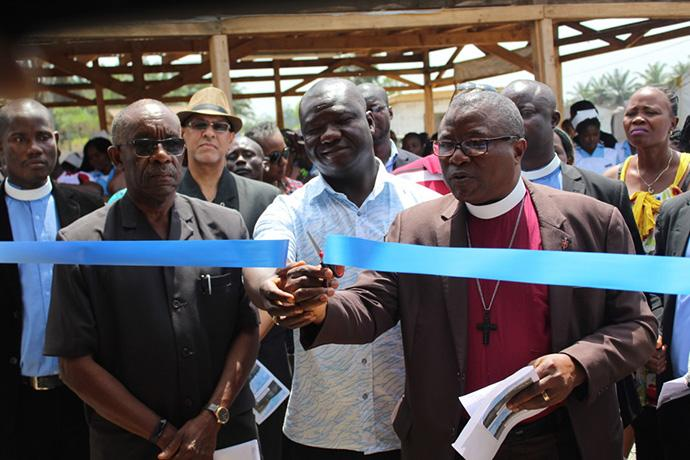Bishop Samuel J. Quire Jr. cuts the ribbon to the new United Methodist University nursing school facilities in Ganta, Liberia. The school is the first College of Health Sciences department to relocate from Monrovia. Photo by E Julu Swen, UMNS.