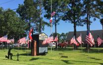 The flag on the main flagpole outside Aldersgate United Methodist Church in Santa Fe, Texas, flies at half-staff in memory of shooting victims at Santa Fe High School, including church member Jared Black, 17. The other flags on the lawn are part of the church's Memorial Day display and the kneeling figure honors fallen police officers. Photo by Sherri Gragg, Cross Connection