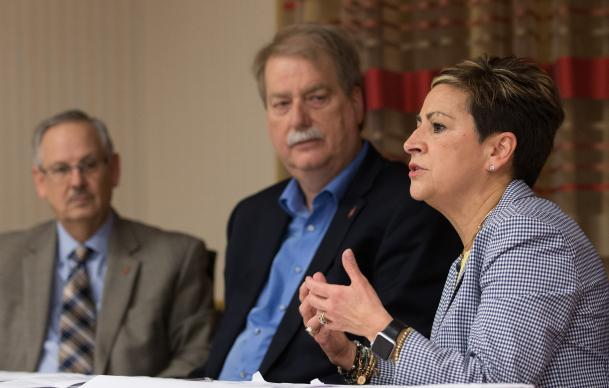 Bishop Cynthia F. Harvey (right) answers questions during a press conference about The United Methodist Church's Way Forward plan to address how the denomination ministers with LGBTQ individuals. She is flanked by Bishops Bruce R. Ough (left) and Kenneth H. Carter following the Council of Bishops meeting in Chicago. Photo by Mike DuBose, UMNS.