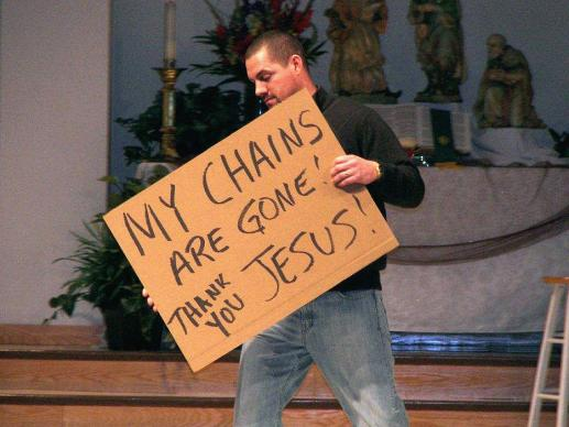 More than a dozen former alcoholics and addicts carried signs telling how it felt to be in recovery during a presentation at the 2012 Oklahoma Annual Conference meeting in Tulsa. Photo by Boyce Bowdon