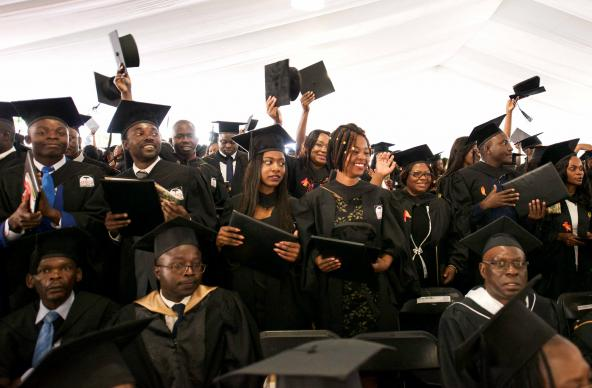 Africa University students celebrate their graduation from the United Methodist-related school in Mutare, Zimbabwe. This year's graduating class had students from 21 African countries. Photo by the Africa University Department of Information and Public Affairs.