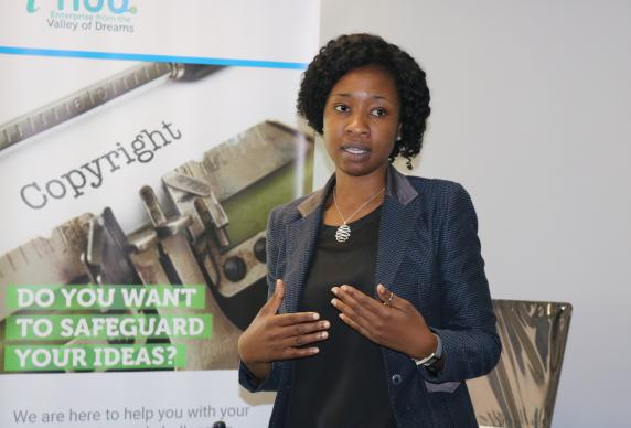 Yollanda Washaya, innovation hub manager for Africa University, works to implement new ideas such as building a biogas digester to recycle waste, operating a 3D printer to create prototypes, and branding. Photo by Eveline Chikwanah, UMNS.