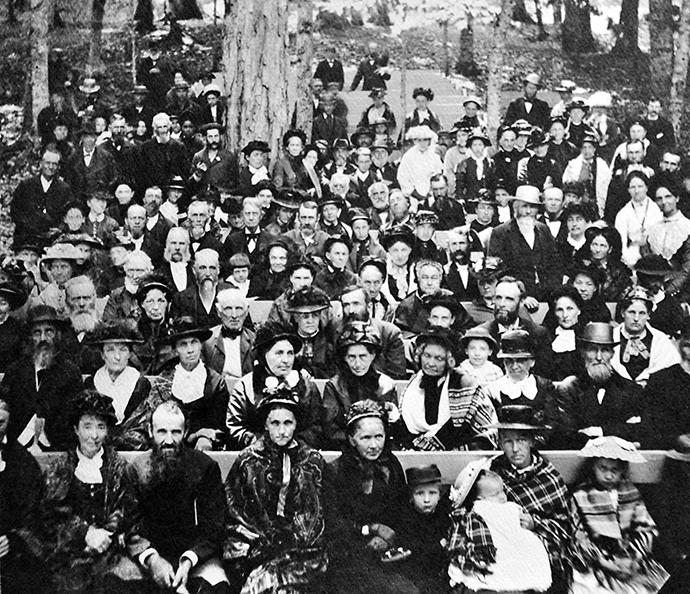 A photographer caught the crowd assembled for the second camp meeting at Bay View, Michigan, in 1877. Methodists founded Bay View, a community that would become known for its cottages and participation in the Chautauqua movement. Bay View has lately faced controversy over its restriction of cottage ownership to Christians. Photo courtesy Bay View Chautauqua Inclusiveness Group