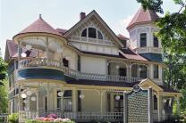 Evelyn Hall (1890), an outstanding example of Queen Anne architecture, is among the public buildings at Bay View, a United Methodist-affiliated summer community in northern Michigan.  Bay View is embroiled in a lawsuit overs its requirement that only practicing Christians can own a cottage there. Photo courtesy Bay View Chautauqua Inclusiveness Group.