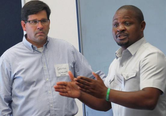 The Rev. Gaston Warner and Reegan Kaberia of the nonprofit ZOE, which works with orphans and other vulnerable children in Africa and India, lead a workshop at the Beyond These Walls mission conference at Chapelwood United Methodist Church in Houston. Photo by Sam Hodges, UMNS.