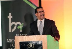 """The Rev. Antoine """"Tony"""" Love, vice chair of the Black Methodists for Church Renewal, delivers a keynote address during the opening plenary session of the March 14-17 BMCR meeting in Sacramento, California. Photo courtesy of the Rev. Love."""
